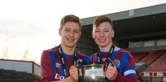 James Woods, left, and Trinity captain Dylan Connolly with the Harding Cup Picture: Seb Daly/Sportsfile
