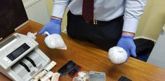 The cash, suspected heroin and other objects seized in the search of a Dublin residence.