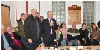 Minister Shane Ross celebrates with the Ballinteer Men's Shed