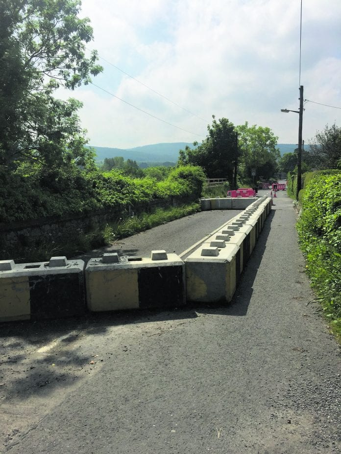 Section of the Edmondstown road where damage was caused by illegal development and has caused much difficulty for the community