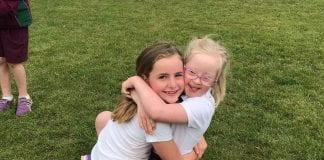 """Lydia (8) said she takes on Challenge 21 because she wants to promote the message that her sister Sophie (7) is """"just like everyone else"""""""