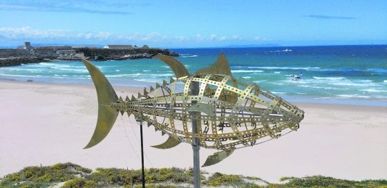 A steel statue skeleton of a Bluefin Tuna fish on a Spanish beach.